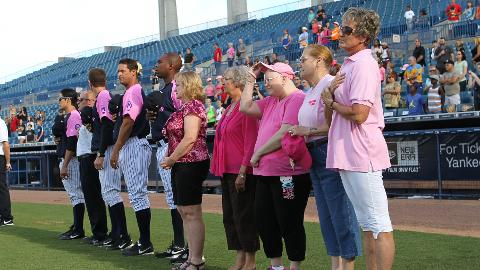Breast Cancer survivors took the field with the T-Yanks for the National Anthem. (Mark LoMoglio/Yankees)